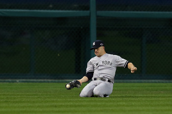 Brett Gardner makes a sliding catch during Game 3 of the 2012 ALCS against the Detroit Tigers