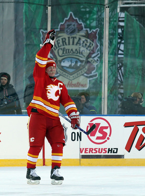 CALGARY, AB - FEBRUARY 19: Lanny McDonald #9 of the Calgary Flames Alumni celebrates his penalty shot goal against the Montreal Canadiens Alumni during the Alumni game held as part of the 2011 NHL Heritage Classic festivities at McMahon Stadium on Februar