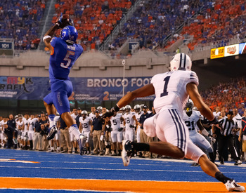 Jamar Taylor snags this interception on the blue turf of Boise State.