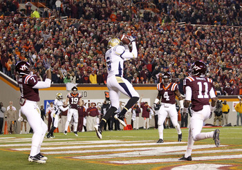 Rod Sweeting picks off a pass against Virginia Tech.