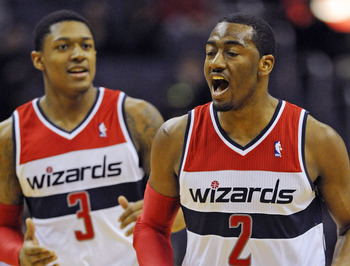 Washington Wizards' John Wall (2), Bradley Beal (3)