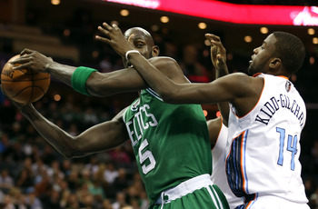 CHARLOTTE, NC - FEBRUARY 11:  Kevin Garnett #5 of the Boston Celtics keeps the ball away from Michael Kidd-Gilchrist #14 of the Charlotte Bobcats during their game at Time Warner Cable Arena on February 11, 2013 in Charlotte, North Carolina. NOTE TO USER: