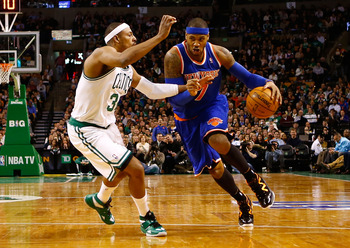 BOSTON, MA - JANUARY 24:  Carmelo Anthony #7 of the New York Knicks drives to the basket in front of Paul Pierce #34 of the Boston Celtics during the game on January 24, 2013 at TD Garden in Boston, Massachusetts. NOTE TO USER: User expressly acknowledges