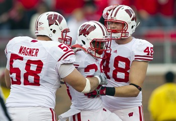 Wagner (No. 58) comes from the offensive lineman factory that is Wisconsin.