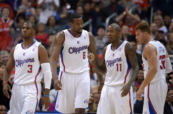 Dec 5, 2012; Los Angeles, CA, USA; Los Angeles Clippers guard Jamal Crawford (11) celebrates with teammates Chris Paul (3), DeAndre Jordan (6) and Blake Griffin (32) after making a 3-point basket while being fouled in the second quarter against the Dallas