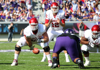Sooners quarterback Landry Jones takes the snap against TCU in the regular-season finale, Dec. 1.