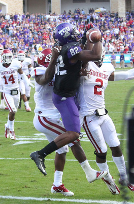 TCU's Josh Boyce leaps for a touchdown pass in a game against Oklahoma, Dec. 1.