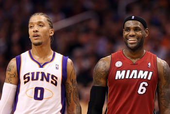 PHOENIX, AZ - NOVEMBER 17:  Michael Beasley #0 of the Phoenix Suns and LeBron James #6 of the Miami Heat during the NBA game at US Airways Center on November 17, 2012 in Phoenix, Arizona.  The Heat defeated the Suns 97-88. NOTE TO USER: User expressly ack