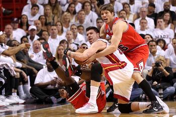 MIAMI, FL - MAY 22:  Kyle Korver #26 (R) and Ronnie Brewer #11 of the Chicago Bulls fight for a loose ball against Mike Miller #13 of the Miami Heat in Game Three of the Eastern Conference Finals during the 2011 NBA Playoffs on May 22, 2011 at American Ai