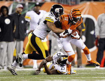 Oct 21, 2012; Cincinnati, OH, USA; Cincinnati Bengals wide receiver Mohamed Sanu (12) is brought down by the Pittsburgh Steelers inside linebacker Larry Foote (50) during the first half at Paul Brown Stadium. Mandatory Credit: Frank Victores-USA TODAY Spo