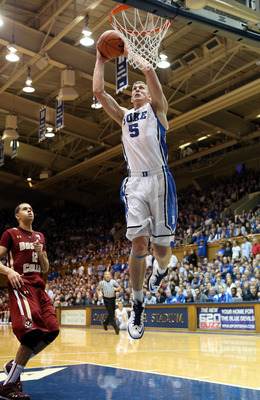 DURHAM, NC - FEBRUARY 24:  Ryan Anderson #12 of the Boston College Eagles watches as Mason Plumlee #5 of the Duke Blue Devils dunks the ball during their game at Cameron Indoor Stadium on February 24, 2013 in Durham, North Carolina.  (Photo by Streeter Le