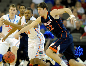 OMAHA, NE - MARCH 16:  (L-R) Bradley Beal #23 of the Florida Gators fights for control of a loose ball in the first half against Joe Harris #12 of the Virginia Cavaliers during the second round of the 2012 NCAA Men's Basketball Tournament at CenturyLink C