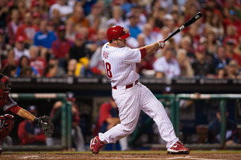 Sep 27, 2012; Philadelphia, PA, USA; Philadelphia Phillies left fielder Darin Ruf (18) hits a three run double during the first inning against the Washington Nationals  at Citizens Bank Park. Mandatory Credit: Howard Smith-USA TODAY Sports