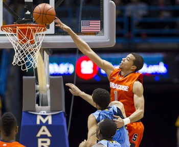 Feb 25, 2013; Milwaukee, WI, USA;  Syracuse guard Michael Carter-Williams (1) dunks over Marquette forward Juan Anderson (10) during the first half at the BMO Harris Bradley Center.  Mandatory Credit: Jeff Hanisch-USA TODAY Sports