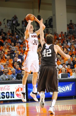 Mar 7, 2012;  Lewisburg, PA, USA; Bucknell Bison center Mike Muscala (31) shoots over Lehigh Mountain Hawks forward Gabe Knutson (42) in the first half during the finals of the 2012 Patriot League Conference Tournament at Sojka Pavilion. Lehigh won 82-77.