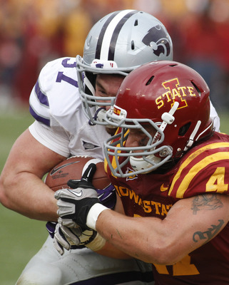 AMES, IA- OCTOBER 13:  Fullback Braden Wilson #37 of the Kansas State Wildcats makes helmet to hemet contact during the fourth quarter with linebacker A.J. Klein #47 of the Iowa State Cyclones on October 13, 2012 at Jack Trice Stadium in Ames, Iowa.  Kans