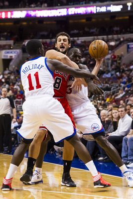 Dec 12, 2012; Philadelphia, PA, USA; Chicago Bulls guard Marco Belinelli (8) is double teamed by Philadelphia 76ers guard Jrue Holiday (11) and guard Jason Richardson (23) during the first quarter at the Wells Fargo Center. The Bulls defeated the Sixers 9
