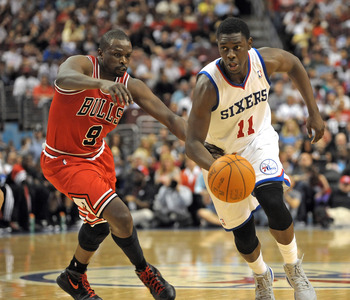 May 4, 2012; Philadelphia, PA, USA; Philadelphia 76ers point guard Jrue Holiday (11) drives past Chicago Bulls small forward Luol Deng (9) during the first half of game three in the Eastern Conference quarterfinals of the 2012 NBA Playoffs at Wells Fargo
