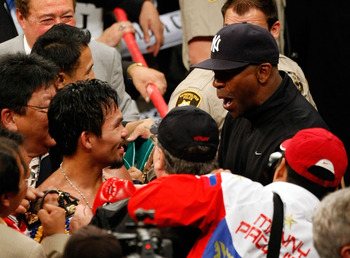 Denzel Washington congratulates Manny Pacquiao after knocking out Ricky Hatton.