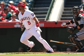 Pujols' high batting average will help push his RBI total past Hamilton's.