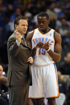 Feb 22, 2013; Oklahoma City, OK, USA; Oklahoma City Thunder head coach Scott Brooks discusses a play with Thunder guard Reggie Jackson (15) in action against the Minnesota Timberwolves during the second half at Chesapeake Energy Arena. Mandatory Credit: M