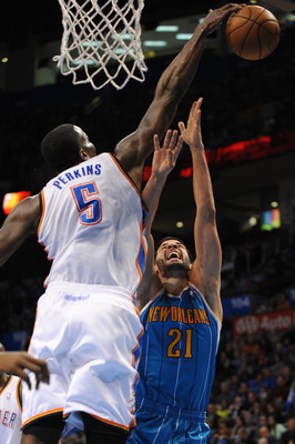Feb 27, 2013; Oklahoma City, OK, USA; Oklahoma City Thunder center Kendrick Perkins (5) blocks a shot attempt by New Orleans Hornets guard Greivis Vasquez (21) during the second half at Chesapeake Energy Arena. Mandatory Credit: Mark D. Smith-USA TODAY Sp