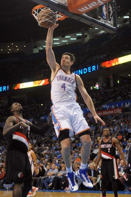 Nov 2, 2012; Oklahoma City, OK, USA; Oklahoma City Thunder forward Nick Collison (4) dunks the ball against Portland Trail Blazers center J.J.Hickson (21) during the second half at Chesapeake Energy Arena.  Mandatory Credit: Mark D. Smith-USA TODAY Sports