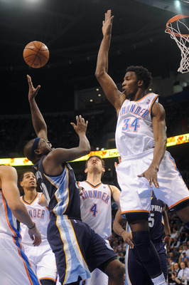 Nov 14, 2012; Oklahoma City, OK, USA; Memphis Grizzlies forward Zach Randolph (50) attempts a shot against Oklahoma City Thunder center Hasheem Thabeet (34) during the first half at Chesapeake Energy Arena.  Mandatory Credit: Mark D. Smith-USA TODAY Sport
