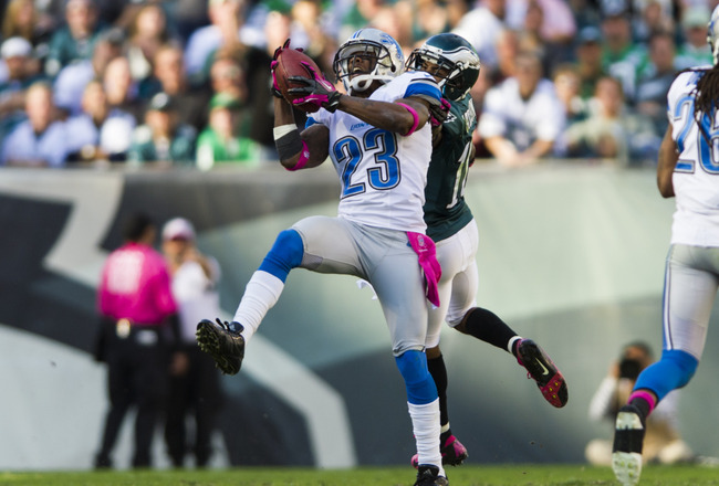 Oct 14, 2012; Philadelphia, PA, USA; Detroit Lions cornerback Chris Houston (23) intercepts a pass in front of Philadelphia Eagles wide receiver DeSean Jackson (10) during the fourth quarter at Lincoln Financial Field. The Lions defeated the Eagles 26-23