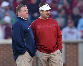 Oct 27, 2012; Norman, OK, USA; Oklahoma Sooners head coach Bob Stoops meets prior to the game with Notre Dame Fighting Irish head coach Brian Kelly (left) at Oklahoma Memorial Stadium. Mandatory Credit: Matthew Emmons-USA TODAY Sports