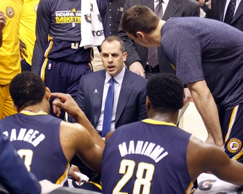 Mar 1, 2013; Toronto, Ontario, CAN; Indiana Pacers head coach Frank Vogel (center) talks to his team during a break in the action against the Toronto Raptors at the Air Canada Centre. Indiana defeated Toronto 93-81. Mandatory Credit: John E. Sokolowski-US