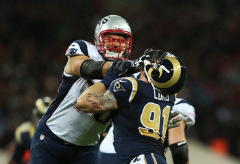 Vollmer gets the best of the Rams' Chris Long.