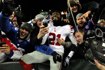 Phillips celebrating a Super Bowl victory with fans.