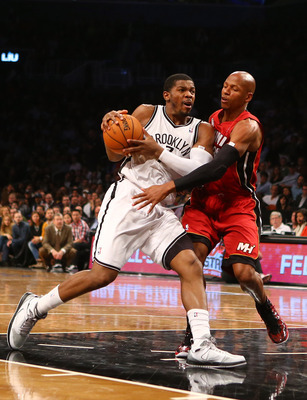NEW YORK, NY - JANUARY 30:  Joe Johnson #7 of the Brooklyn Nets drives against Ray Allen #34 of the Miami Heat during their game at the Barclays Center on January 30, 2013 in the Brooklyn borough of New York City. NOTE TO USER: User expressly acknowledges
