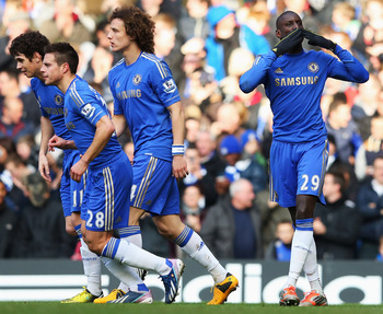 Demba Ba salutes the Chelsea crowd after his goal.