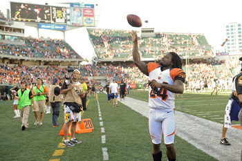 CINCINNATI, OH - SEPTEMBER 16:  Adam Jones #24 of the Cincinnati Bengals throws a football to a fan after the game against the Cleveland Browns at Paul Brown Stadium on September 16, 2012 in Cincinnati, Ohio.  (Photo by Jamie Sabau/Getty Images)