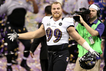 Baltimore linebacker Paul Kruger celebrating after winning the Superbowl