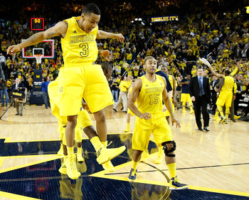 Jon Horford (No. 15) and Michigan can celebrate the fact it is still in play for a No. 1 seed.