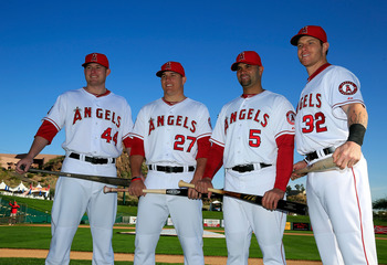 Josh Hamilton (R) joins an already-potent Angels offense.