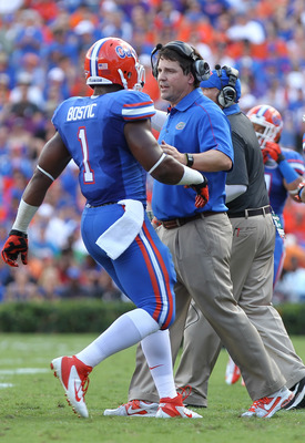 October 6, 2012; Gainesville FL, USA; Florida Gators head coach Will Muschamp talks with linebacker Jon Bostic (1) during the first quarter against the LSU Tigers at Ben Hill Griffin Stadium. Mandatory Credit: Kim Klement-USA TODAY Sports