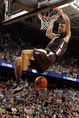 GREENSBORO, NC - MARCH 16:  Gabe Knutson #42 of the Lehigh Mountain Hawks dunks the ball in the second half against the Duke Blue Devils during the second round of the 2012 NCAA Men's Basketball Tournament at Greensboro Coliseum on March 16, 2012 in Green