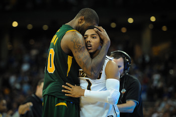 OMAHA, NE - MARCH 16: Kyle O'Quinn #10 of the Norfolk State Spartans comforts Phil Pressey #1 of the Missouri Tigers after the Sprtans upset the Tigers during the second round of the NCAA Mens Basketball Tournament at CenturyLink Center March 16, 2012 in