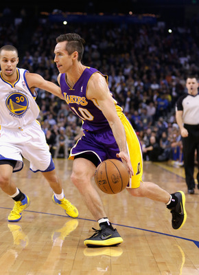 Steve Nash beats Stephen Curry off the dribble.