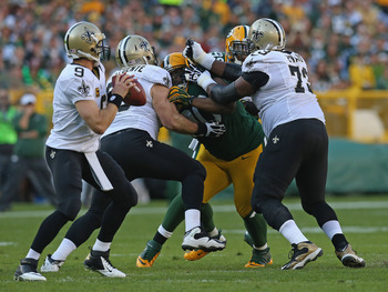 Brian de la Puente will almost certainly be blocking for Drew Brees again in 2013. He's among seven current Saints who figure to be re-signed as free agents.
