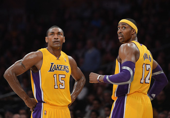 LOS ANGELES, CA - JANUARY 15:  Dwight Howard #12 and Metta World Peace #15 of the Los Angeles Lakers look back during a 104-88 win over the Milwaukee Bucks at Staples Center on January 15, 2013 in Los Angeles, California.  NOTE TO USER: User expressly ack