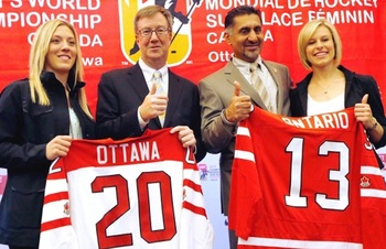 Agosta (left) with Tessa Bonhomme (far right) at the official announcement that the city of Ottawa would host the 2013 IIHF Women's Worlds, Photograph by David Kawai of the Ottawa Citizen