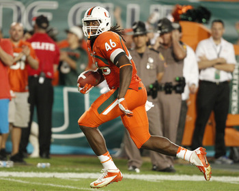 MIAMI GARDENS, FL - NOVEMBER 17: Clive Walford #46 of the Miami Hurricanes runs with the ball for a touchdown against the South Florida Bulls on November 17, 2012 at Sun Life Stadium in Miami Gardens, Florida. The Hurricanes defeated the Bulls 40-9. (Phot