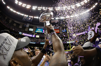 The Ravens hold up the Lombardi Trophy.