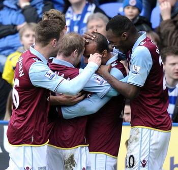 Gabriel Agbonlahor is mobbed by Aston Villa teammates after his goal at Reading.