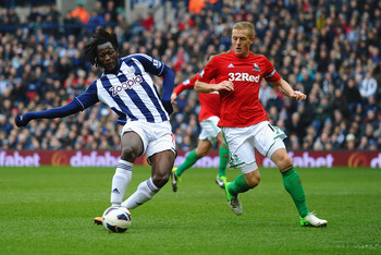 Romelu Lukaku slots home for West Brom in the 2-1 win over Swansea.